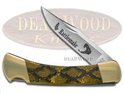 Buck 110 Folding Hunter Knife Rattlesnake Gold Pearl Corelon 420HC Stainless